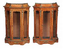 A pair of tulipwood and gilt metal mounted vitrines, circa 1870