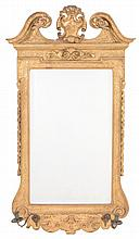 A carved and giltwood wall mirror in George II style , 19th century