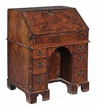 A George II walnut bureau , circa 1735, the fall opening to leather inset...