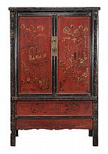 A Chinese red and black lacquer cupboard, late 19th/ 20th century, 181cm high