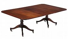 A mahogany twin pillar dining table, late 19th century and later