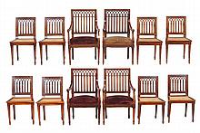 A set of twelve Gothic revival mahogany dining chairs, late 19th century