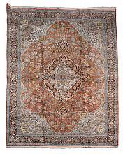 An Oriental silk carpet , approximately 395 x 276cm