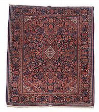 A Kashan rug, approximately 196 x 127cm