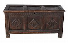 A Charles II oak panelled coffer with carved front , circa 1660