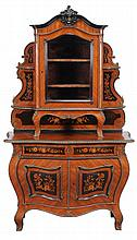 A Continental kingwood and gilt metal mounted vitrine on bombe commode