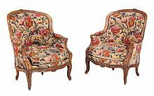 A pair of French walnut and tapestry upholstered armchairs in Louis XVI style