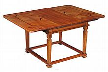 A Continental pale-wood and marquetry inlaid dining table