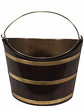 A George III brass bound mahogany bucket, circa 1770, of navette form