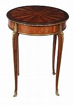 A French mahogany and kingwood circular occasional table, in Louis XVI style