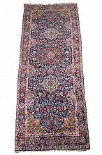 A Kirman carpet, approximately 190 x 481cm