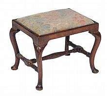 A George III walnut and upholstered stool , late 18th century