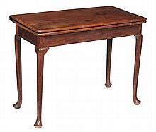 A George II walnut folding card table, circa 1735, with concertina action,