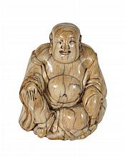 A small ivory carving of Budai, Ming dynasty , shown seated with a smiling face