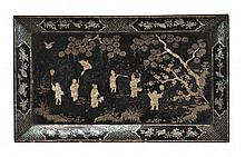 A Chinese lacquer tray of quatre-lobed rectangular form inlaid in mother of...