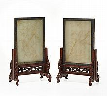 A pair of jade celadon table screens, 19th century , finely etched, to one side