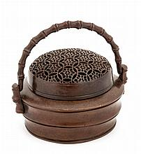 A bronze hand warmer, Qing dynasty , of circular section