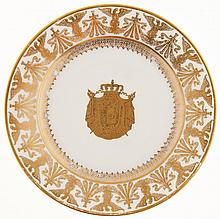 A French white porcelain and gilt Sevres-style plate of Napoleonic interest,