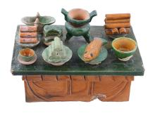 A Chinese sancai glazed pottery model of an altar table and offerings