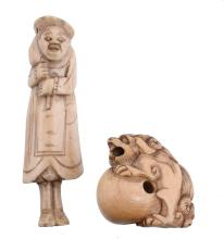 An Ivory Netsuke of a Shishi, the creature sits on its haunches and snarls...