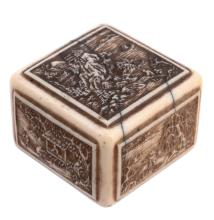 An Ivory Hako Netsuke , the rectilinear object carved in low relief to the...