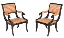 A pair of ebonised armchairs in Empire style , 20th century, each 89cm high