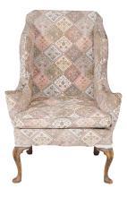 A George III mahogany wing armchair , circa 1770, 118cm high, 83cm wide