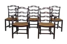 A set of eight mahogany ladder back dining chairs in George III style
