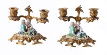 A pair of Meissen porcelain and gilt bronze mounted twin light candelaba