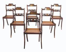 A set of six Regency mahogany and brass inlaid dining chairs, circa 1815,