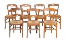 A set of fourteen French elm dining chairs, early 20th century,