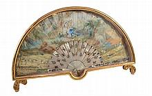 A painted and parcel gilt paper and decorated mother-of-pearl fan