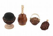 Four coquilla nut and bone or ivory items, mainly early 19th century