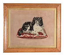 A framed and glazed tapestry picture of Queen Victoria