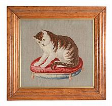 A Victorian framed and glazed needlework picture of a cat on a cushion
