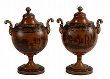 A pair of Dutch tole peinte chestnut urns, early 19th century