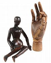 A Victorian carved and stained pine artist's lay figure, late 19th century