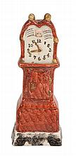 A Staffordshire pearlware model of a longcase clock, first quarter 19th century