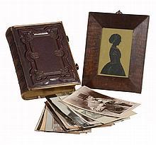 A leather and brass-bound photograph or carte de visite album