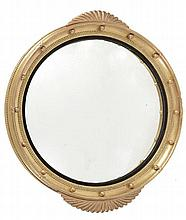 A George III circular giltwood and composition wall mirror, circa 1800