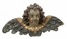 An Italian carved, painted and parcel giltwood winged cherub head