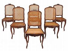 A set of six French walnut and canework dining chairs