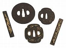 A Circular Iron Hizen Tsuba , the thin plate chased in low relief to either...