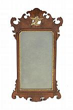 A George II walnut wall mirror, circa 1735