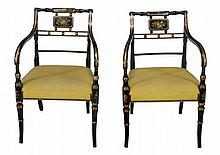 A pair of Regency black painted and parcel gilt elbow chairs , circa 1815