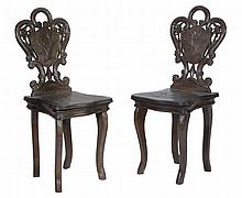 A pair of 'Black Forest' carved and stained wood children's chairs