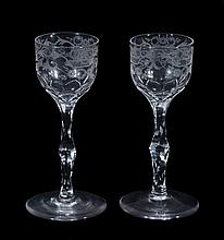 A pair of engraved facet-stemmed wine glasses , late 18th century