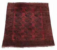 An Afghan carpet , approximately 310 x 430cm