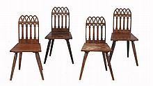 A set of four oak Gothic dining chairs, 19th century