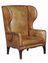 A leather upholstered library chair, in George III style 20th Century